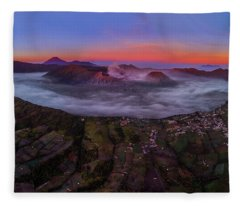 Fleece Blanket featuring the photograph Mount Bromo Misty Sunrise by Pradeep Raja Prints