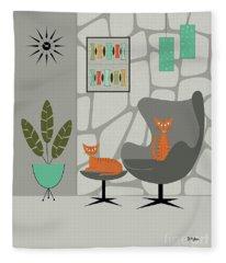 Orange Cat In Gray Stone Wall Fleece Blanket