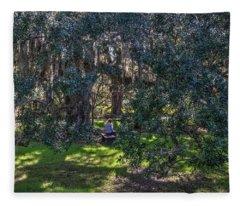 Reading In The Shade Of Live Oaks Fleece Blanket