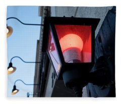 Red Light On The Wall With A Blue Sky And Yellow Bulbs In Holland Michigan Fleece Blanket