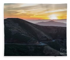 Road On The Edge Of The Mountain With Sunrise In The Background Fleece Blanket