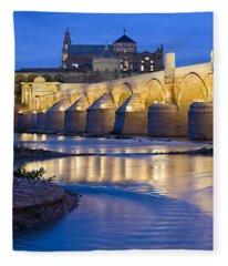 Roman Bridge On Guadalquivir River At Dawn Fleece Blanket