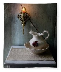 Rustic Water Closet With Brass Sconce And A Pretty Floral Patter Fleece Blanket