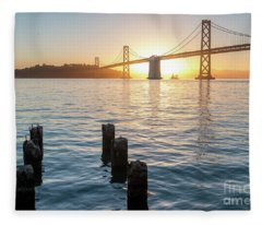 Six Pillars Sticking Out The Water With Bay Bridge In The Backgr Fleece Blanket