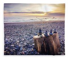 Stacked Rocks At Sunset Fleece Blanket