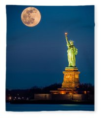 Statue Of Liberty And A Rising Supermoon In New York City Fleece Blanket