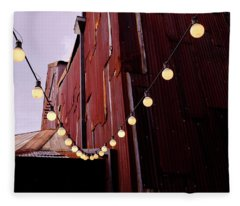 String Of Lights Near An Old Brown Building In Saint Augustine F Fleece Blanket