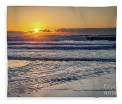 Sun Behind Clouds With Beach And Waves In The Foreground Fleece Blanket