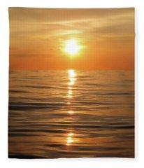 Sun Setting Over Calm Waters Fleece Blanket