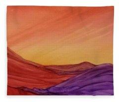 Sunset On Red And Purple Hills Fleece Blanket