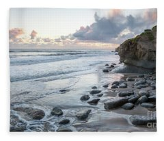 Sunset View In The Distance With Large Rocks On The Beach Fleece Blanket