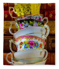 Tea Cups Stacked Against Old Books Fleece Blanket