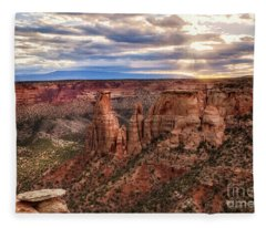 The Sun Coming Up Over The Colorado National Monument Fleece Blanket