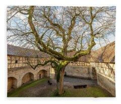 Tree In The Courtyard Fleece Blanket