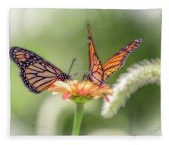 Two Butterflys Working On A Flower. Fleece Blanket
