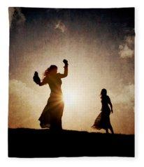 Two Women Dancing At Sunset Fleece Blanket