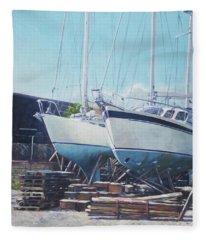 Two Yachts Receiving Maintenance In A Yard Fleece Blanket