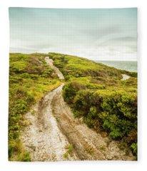 Vibrant Green Hills And Ocean Tracks Fleece Blanket