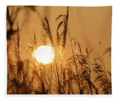 View Of Sun Setting Behind Long Grass B Fleece Blanket