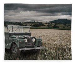 Vintage Land Rover In Field Fleece Blanket