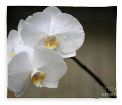 Wet White Orchids Fleece Blanket