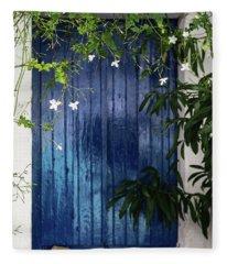 White Flowers On Vine Hanging In Front Of Blue Shuttered Window In Greece Fleece Blanket