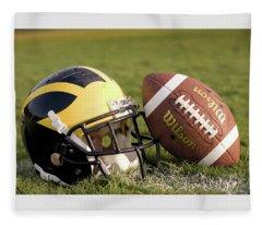 Wolverine Helmet With Football On The Field Fleece Blanket