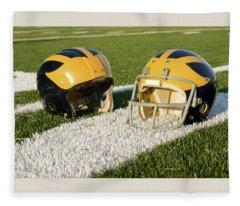 Wolverine Helmets From Different Eras On The Field Fleece Blanket