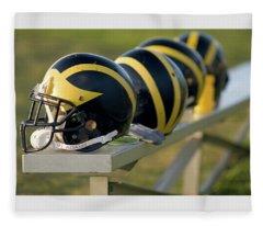 Wolverine Helmets On A Bench Fleece Blanket