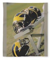 Wolverine Helmets On A Football Bench Fleece Blanket