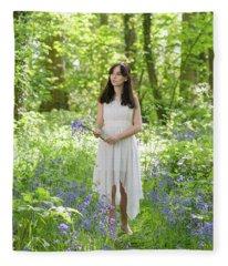 Woman Walking Through Bluebells Fleece Blanket