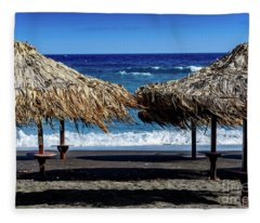 Wood Thatch Umbrellas On Black Sand Beach, Perissa Beach, In Santorini, Greece Fleece Blanket