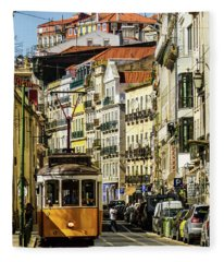 Yellow Tram In Downtown Lisbon, Portugal Fleece Blanket