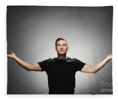 Young Handsome Man Spreading His Hands And Looking Up. Fleece Blanket
