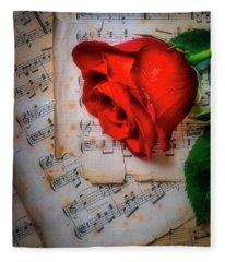 Red Rose On Sheet Music Fleece Blanket