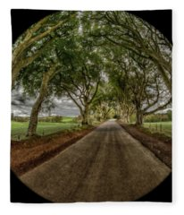 Fleece Blanket featuring the photograph The Dark Hedges by Chris Cousins