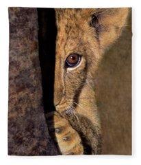 A Lion Cub Plays Hide And Seek Wildlife Rescue Fleece Blanket