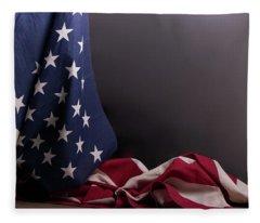American Flag Draped On Itself Fleece Blanket