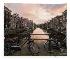 Bicycles And Canal Houses In Amsterdam At Sunset Fleece Blanket