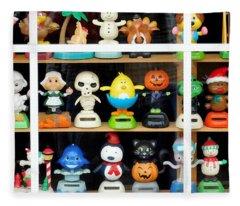 Bobbleheads In Store Window In Schroon Lake Ny In Adirondacks Fleece Blanket