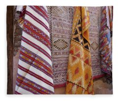 Bright Colored Patterns On Throw Rugs In The Medina Bazaar  Fleece Blanket