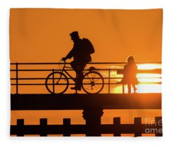 Cyclist Silhouetted At Sunset Fleece Blanket
