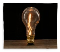Fire Sparks Inside A Light Bulb Fleece Blanket