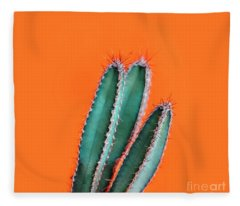 Green Cactus Closeup Over Bright Orange Pastel Background. Color Fleece Blanket
