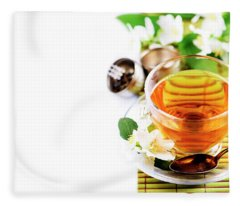 Herbal Green Tea With Jasmine Flower In Transparent Teacup Borde Fleece Blanket