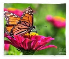 Monarch Visiting Zinnia Fleece Blanket