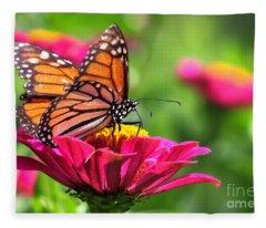 Monarch Visiting Zinnia Fleece Blanket