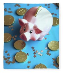 Piggy Bank On The Background With The  Chocoladen Coins Fleece Blanket