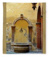Sienna Fountain Courtyard Fleece Blanket