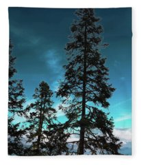 Silhouette Of Tall Conifers In Autumn Fleece Blanket